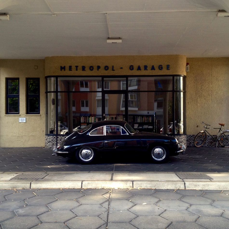 #bike #black  #books #City #downtown #garage #late Summer #metropol #Old Car #reflection #retro #secret Spot #Shining #Silver #Window #yellow Architecture