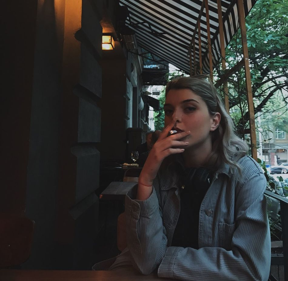 Young Adult Young Women One Person Sitting Real People Lifestyles Beautiful Woman Indoors  Women Architecture One Young Woman Only Tensed Day Adult People Cafe