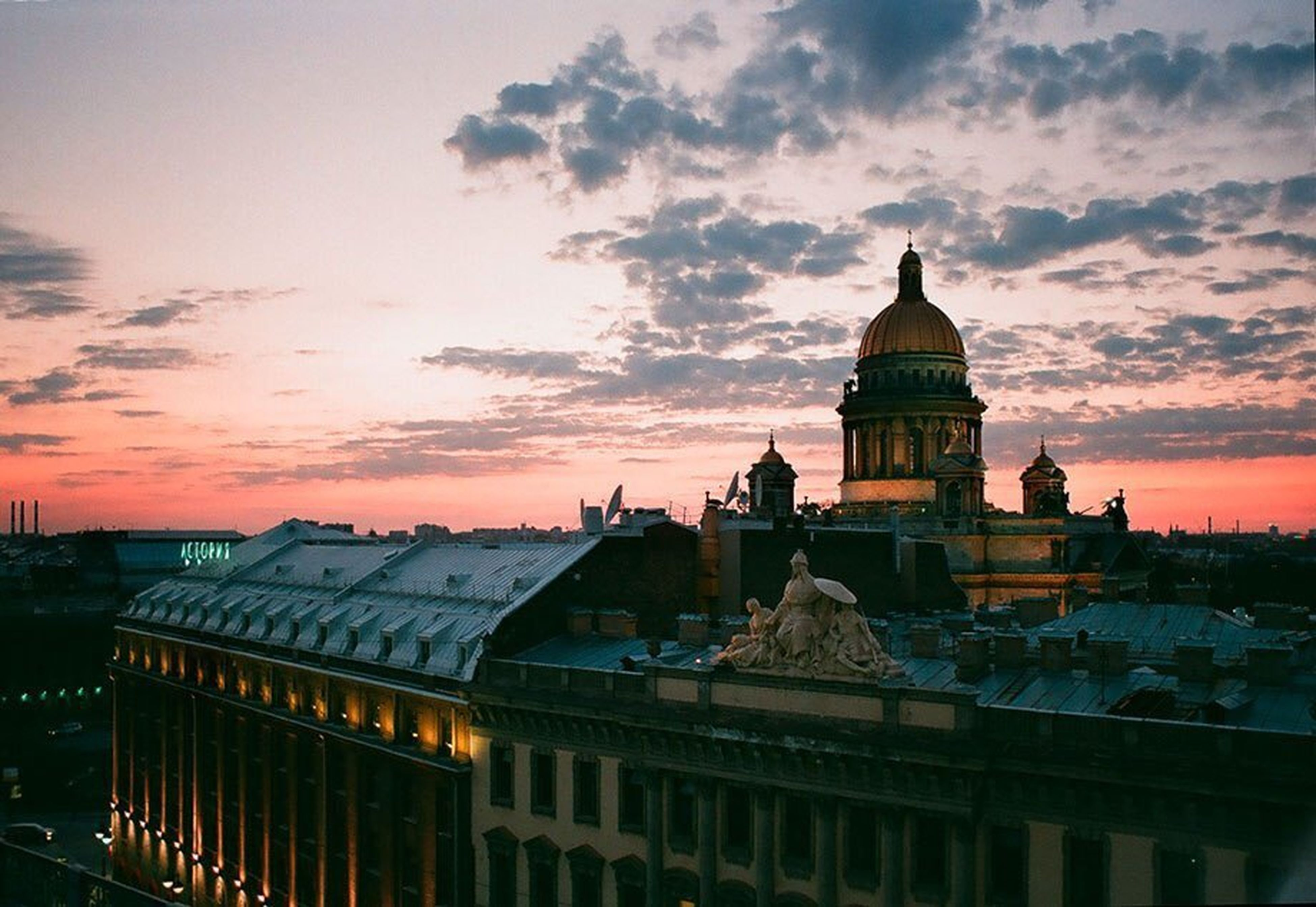 architecture, building exterior, sunset, built structure, sky, cloud - sky, orange color, cloudy, city, dusk, dome, cloud, place of worship, roof, religion, silhouette, outdoors, dramatic sky, spirituality, residential structure