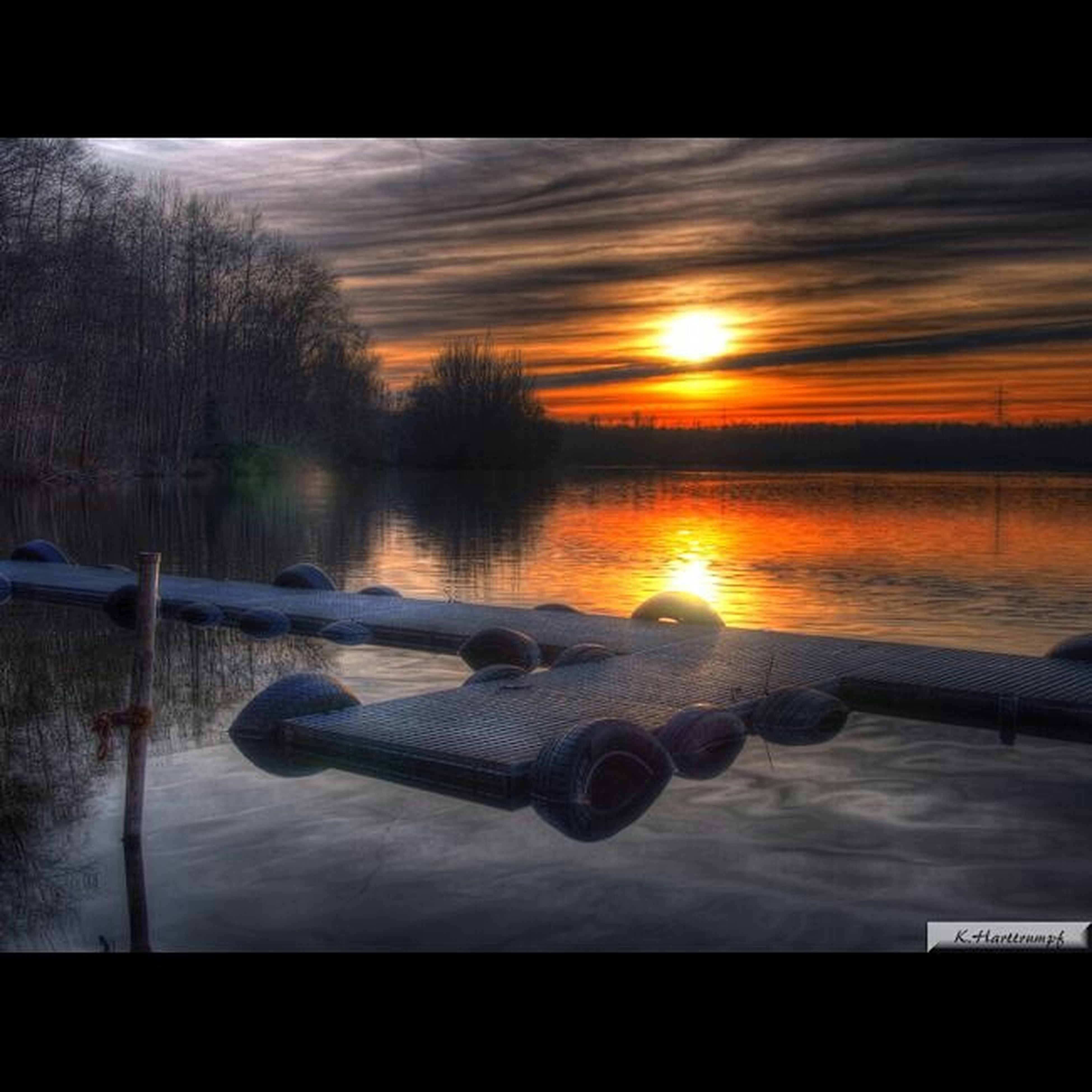 sunset, orange color, sky, water, tranquility, scenics, tranquil scene, lake, beauty in nature, sun, snow, winter, reflection, nature, cold temperature, cloud - sky, transportation, idyllic, sunlight, weather
