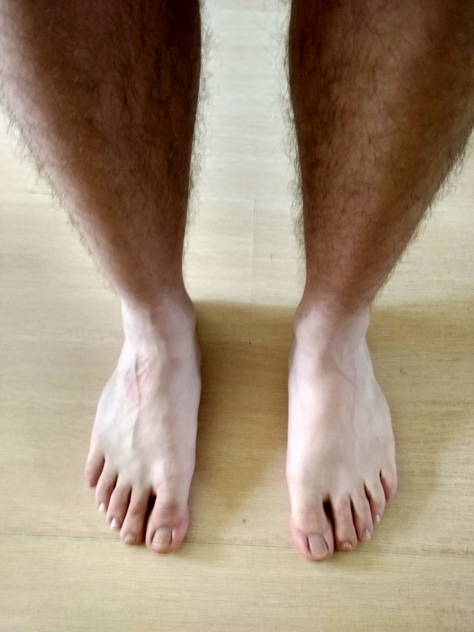 barefoot, human foot, low section, indoors, human leg, hardwood floor, human body part, one man only, relaxation, men, one person, only men, adults only, day, close-up, adult, people