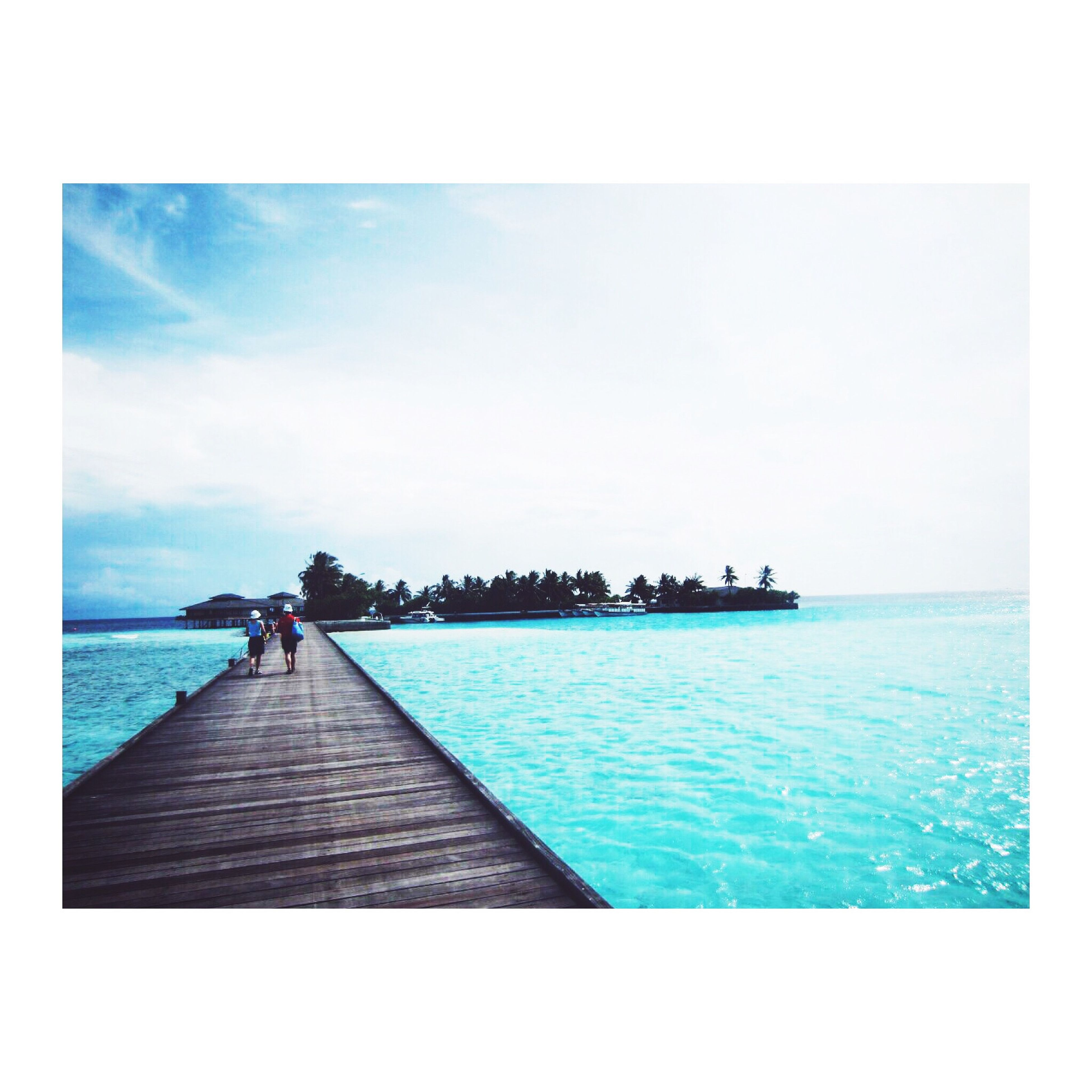 transfer print, water, sea, auto post production filter, horizon over water, men, blue, sky, leisure activity, lifestyles, person, scenics, tranquil scene, nature, rippled, beauty in nature, tranquility, waterfront