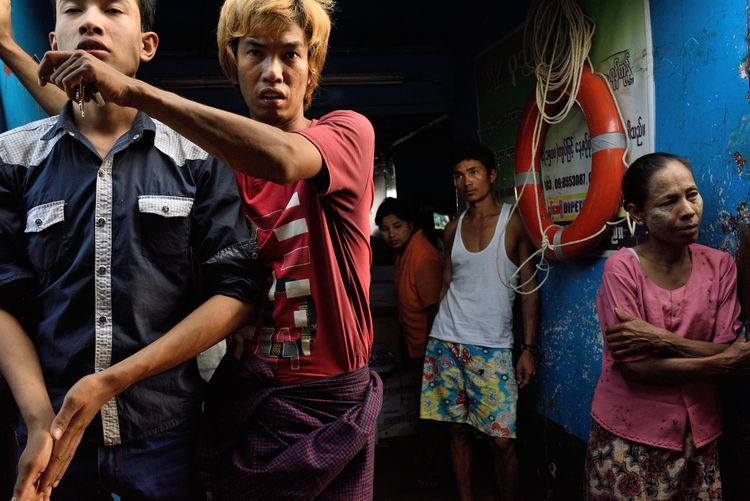 Passengers on a ferry in Yangon Arms Blue Ferry Lifering Myanmar People Street Photography Waving Yangon The Street Photographer - 2017 EyeEm Awards