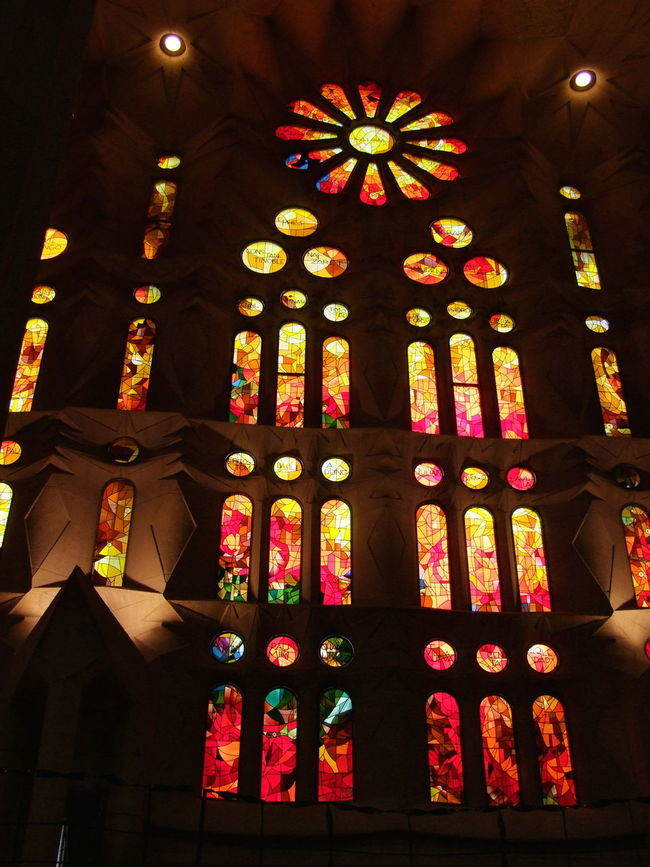 Stained Glass Window, La Sagrada Familia Barcelona Church City Composition Famous Place Full Frame Gaudi Indoor Photography La Sagrada Famila Low Angle View No People Ornate Place Of Worship Religion Script Spaın Spirituality Stained Glass Window Tourism Tourist Attraction  Tourist Destination Window Yellow And Orange Sun Rays
