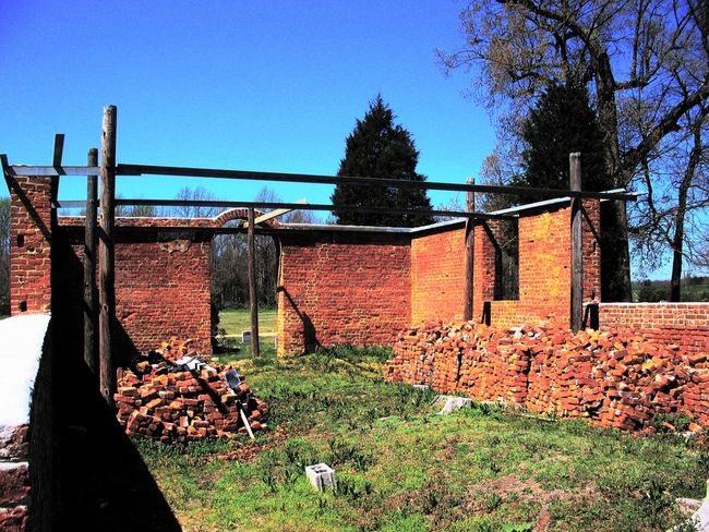 Lawnes Creek Parish Church and Cemetery, Surry County, VA Architecture Blue Brick Wall Built Structure Cemetery Church Day Deterioration Exterior Grass Growth Historical Building Nature No People Old Outdoors Plant Residential Structure Run-down Rural Scene Sky Sunlight Tree
