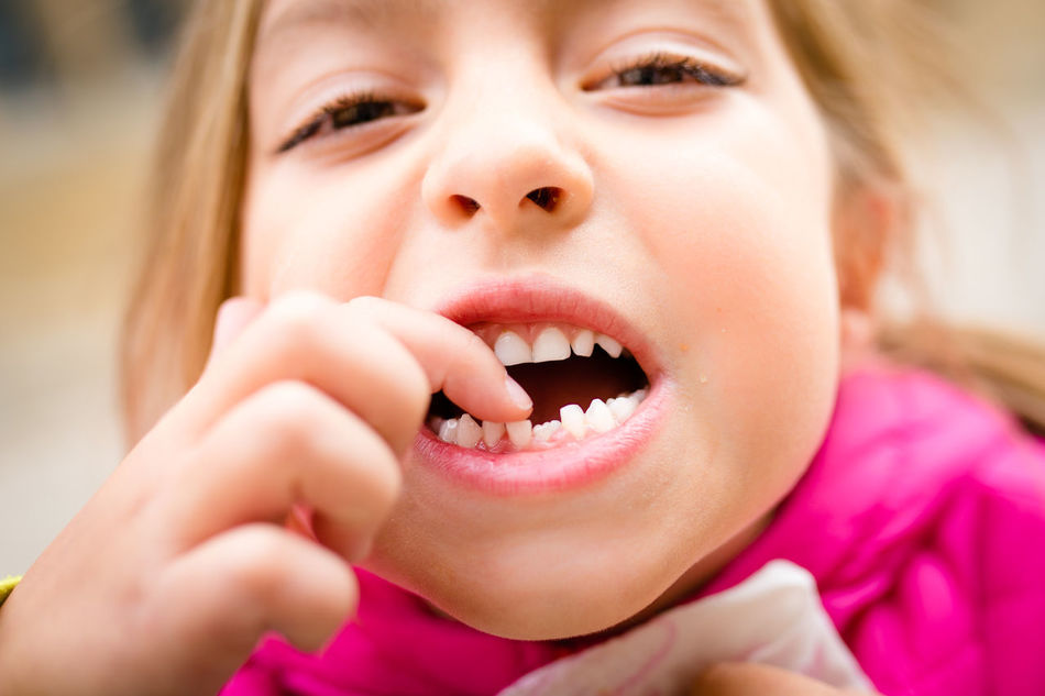6-7 Years Caucasian Close-up Fingers Germany Girl Human Body Part Human Face Human Hand Human Mouth Human Teeth Looking At Camera Milk Teeth Mouth Open Pointing Portrait Showing Showing Imperfection Tooth Gap
