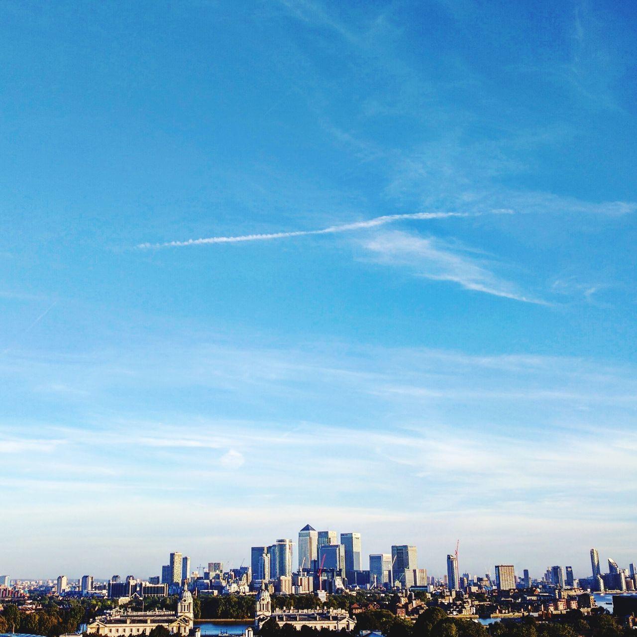 architecture, cityscape, built structure, building exterior, city, skyscraper, sky, blue, cloud - sky, travel destinations, urban skyline, modern, outdoors, day, no people