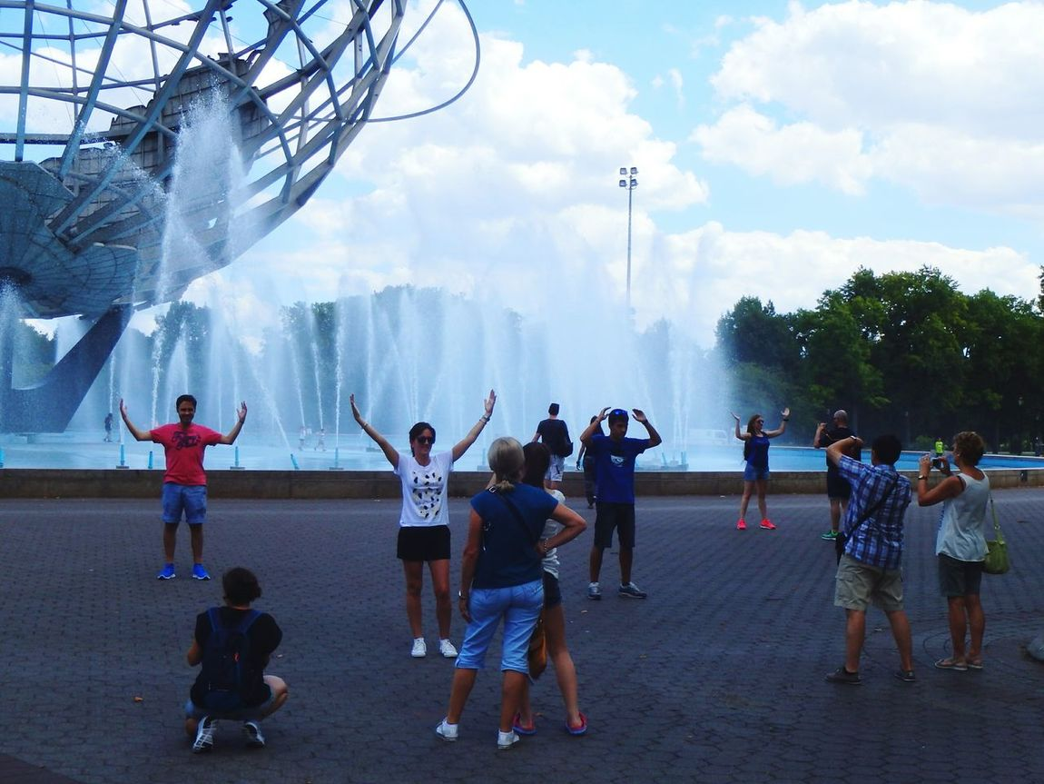 Stick 'em up! Posing Handsup  Tourists Worldsfair Unisphere Fountains The Tourist