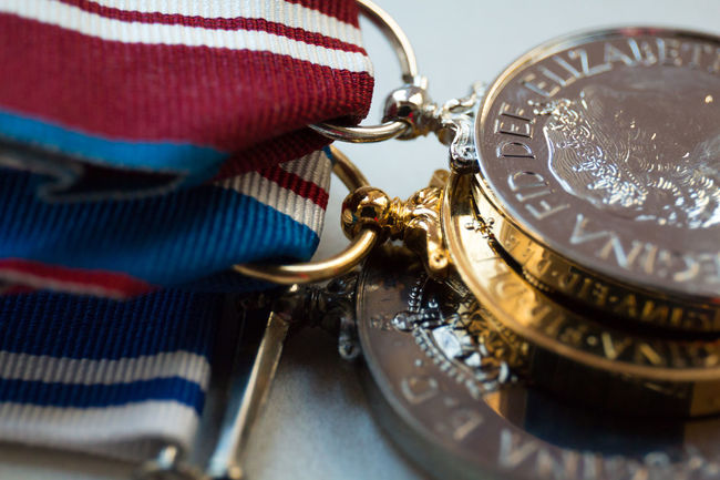 My medals in macro Clasp Close-up Creativity Detail Eye4photography  EyeEm Best Shots Eyeem Closeup EyeEm Gallery EyeEmBestPics Indoors  Macro Photography Medal Medals Metal Queen Ribbon Shiny Still Life White Background