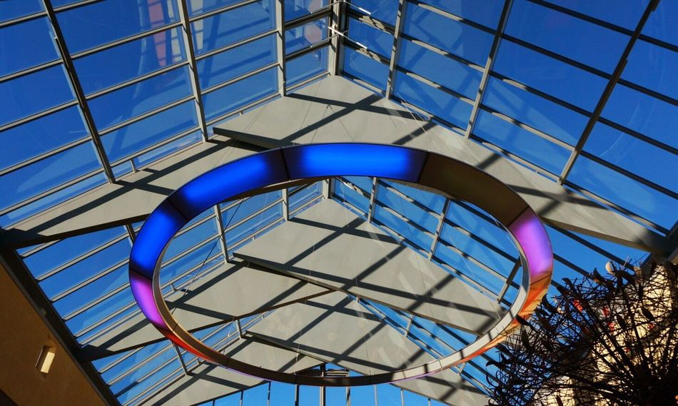 Adapted To The City Architecture Built Structure Low Angle View Lookingup Colors Light And Shadow Light Mall Hillerød Slotsarkaderne Blue Sky Modern Architecture Architecture Building Shopping Mall Architecture_collection Architectural Detail Architecturelovers Shootermag Modern Pattern, Texture, Shape And Form Pattern The City Light The Secret Spaces Art Is Everywhere The Architect - 2017 EyeEm Awards The Graphic City