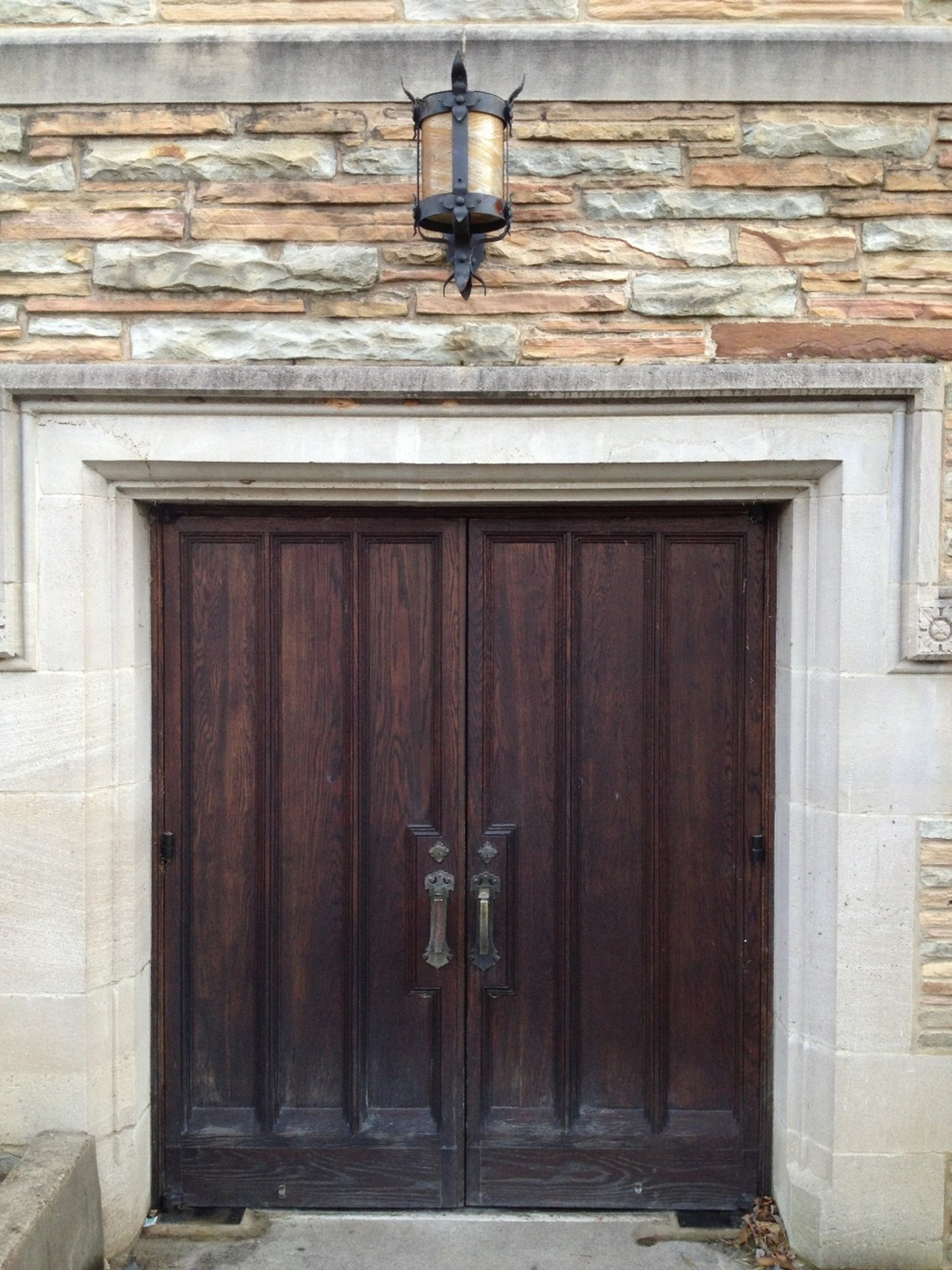 built structure, architecture, door, building exterior, closed, entrance, house, wood - material, safety, lighting equipment, protection, wall - building feature, day, doorway, security, wall, building, outdoors, no people, closed door
