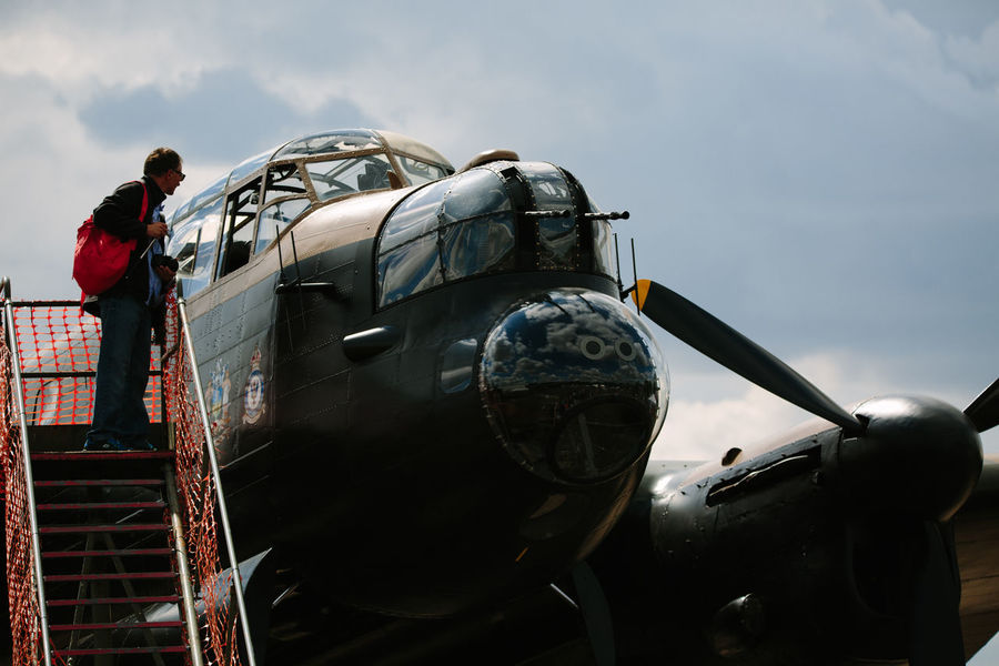 Air Vehicle Avro Anson Day Historic Lancaster Bomber Low Angle View Military Mode Of Transport Outdoors Sky Transportation