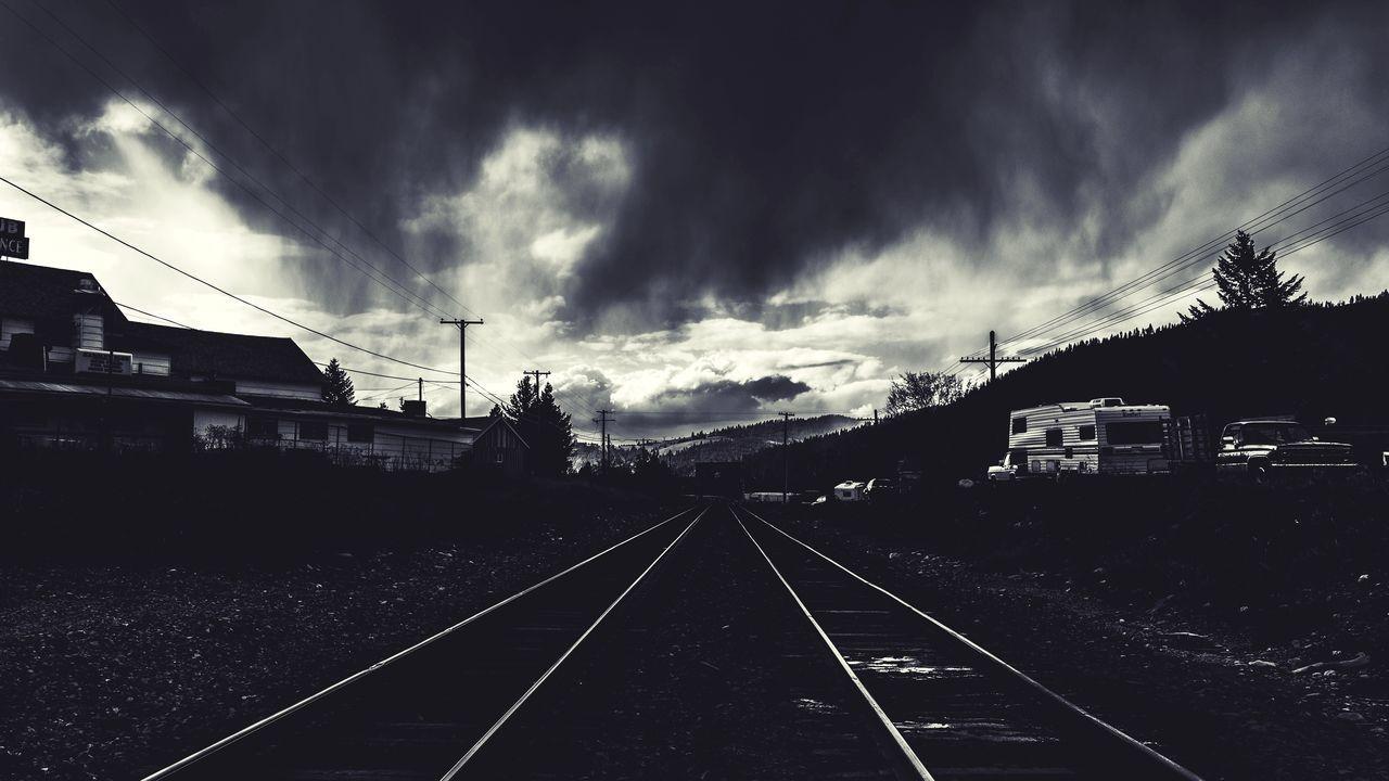 cloud - sky, railroad track, transportation, sky, rail transportation, the way forward, no people, outdoors, storm cloud, travel, day, architecture, built structure, nature, public transportation