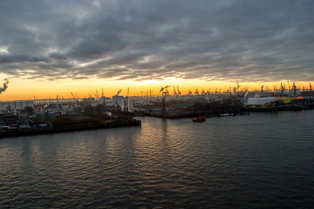 Sunset over Hamburg Harbour. Architecture Cityscape Cloud - Sky Commercial Dock Dramatic Sky Hamburg Hamburg Harbour Hamburg Sunset Hamburger Hafen Harbor Industry No People Orange Sky Orange Sky Sunset Outdoors Sky Sunset Sunset Over Hamburg Water Waterfront