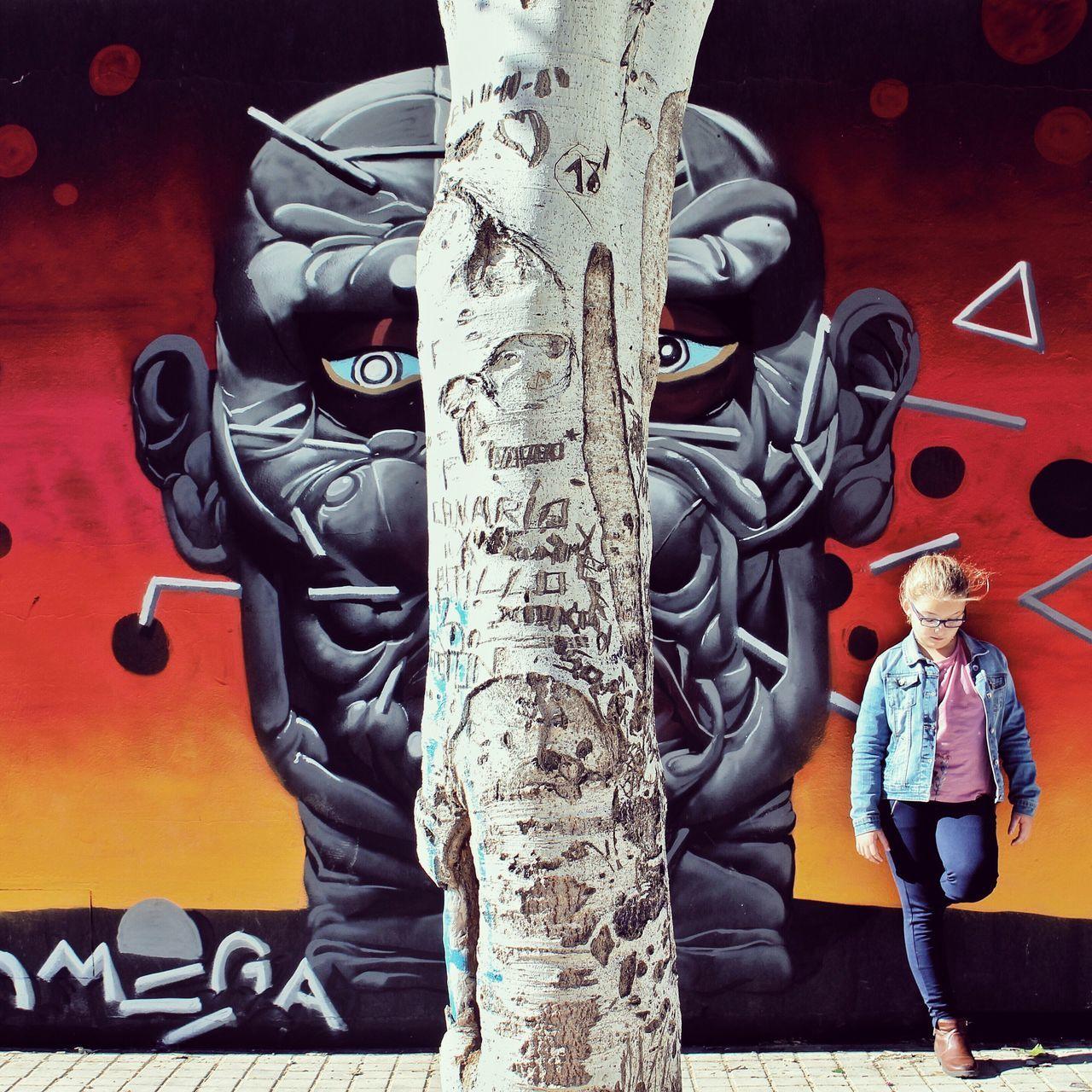 Graffiti Lifestyles People Two People Sword Headwear Shield Outdoors Day Adult