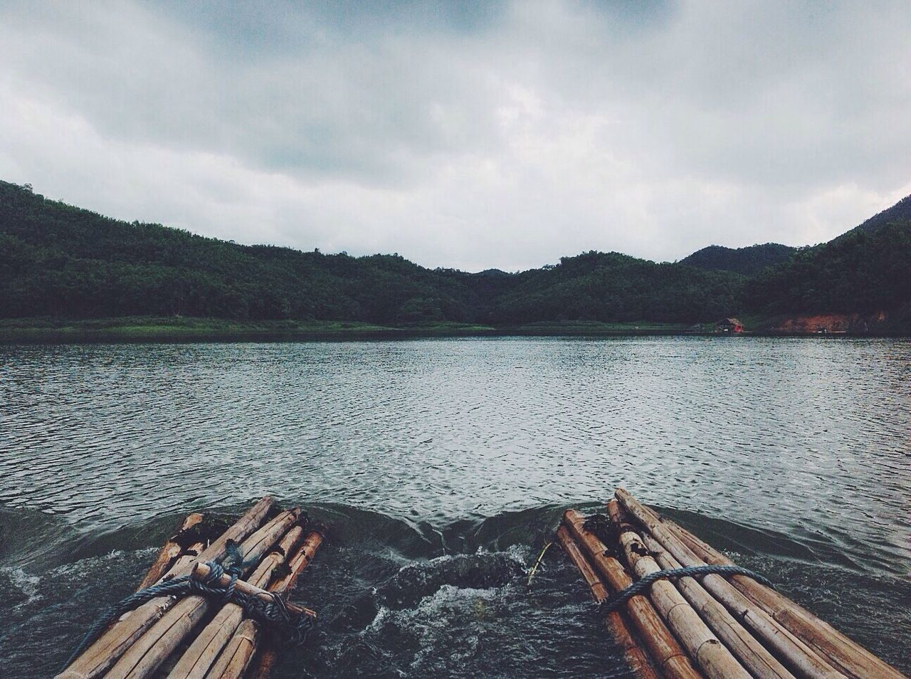 water, wood - material, nature, no people, nautical vessel, tranquility, mountain, outdoors, scenics, day, lake, bamboo - material, tranquil scene, wooden raft, transportation, beauty in nature, sky, raft