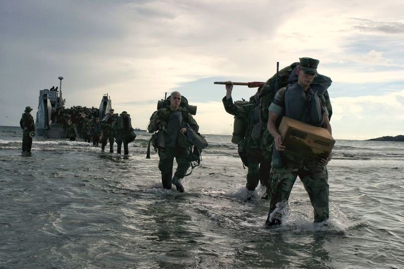 U.S. Marines unload from an Lcu or Landing Craft Utility during a training exercise near Pattaya Thailand Men Walking Military Sky Beach Sea Weapon Real People Army Soldier Cloud - Sky Water Outdoors Standing War Large Group Of People Military Uniform Nature Camouflage Training Awesome EyeEmNewHere Perspectives On People
