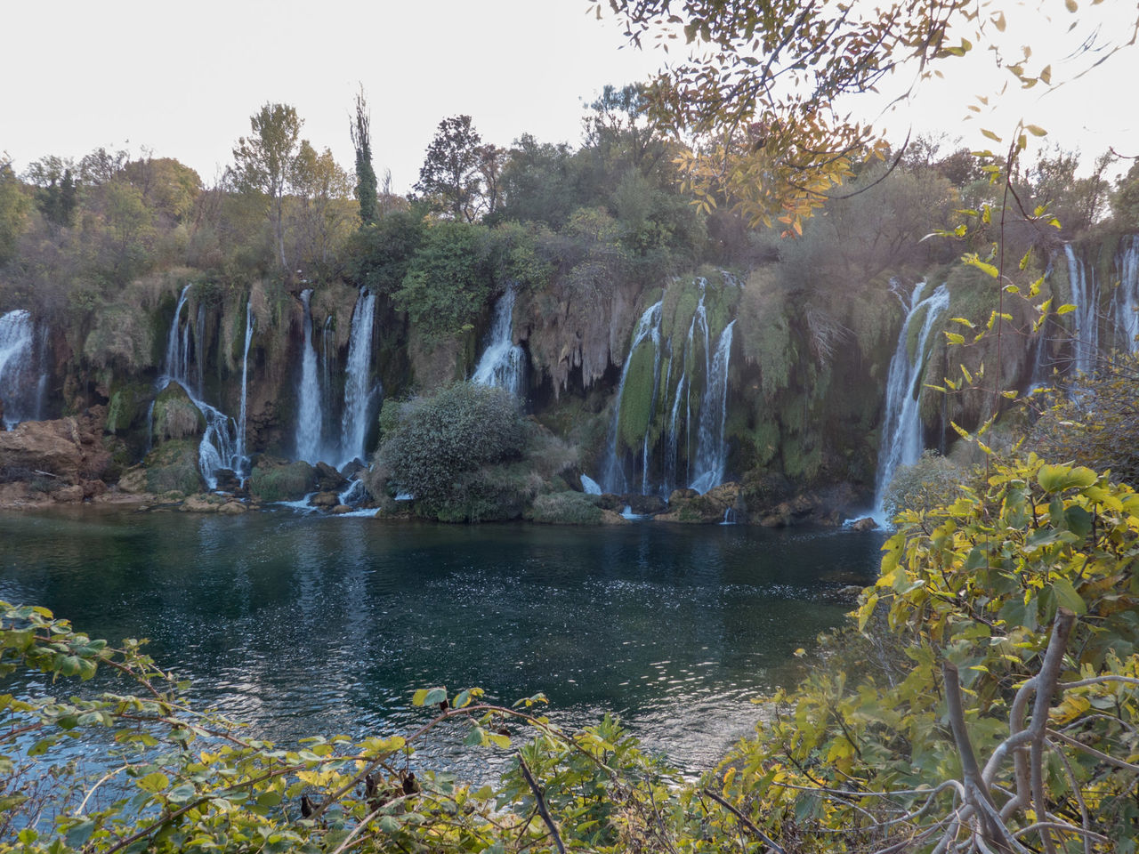 Tree Water Nature No People Fountain Beauty In Nature Landscape Kravice Boat Reflection Nature Waterfall Famous Place Bosnia And Herzegovina Kravica, Bosnia & Herzegovina Tourism Lonely Tourist Attraction  Outdoors Tree Tourist