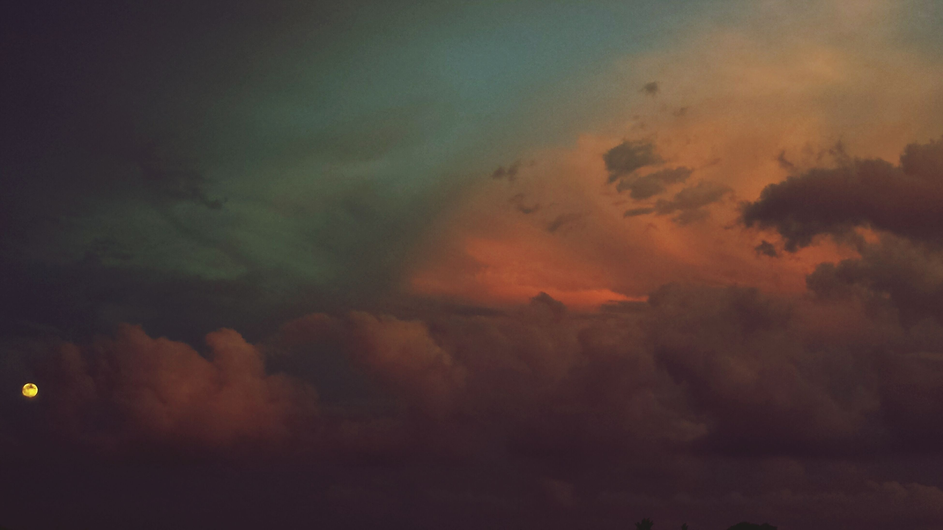 sky, cloud - sky, scenics, beauty in nature, sunset, tranquility, tranquil scene, cloudy, dramatic sky, weather, nature, low angle view, idyllic, cloudscape, overcast, silhouette, orange color, sky only, storm cloud, atmospheric mood
