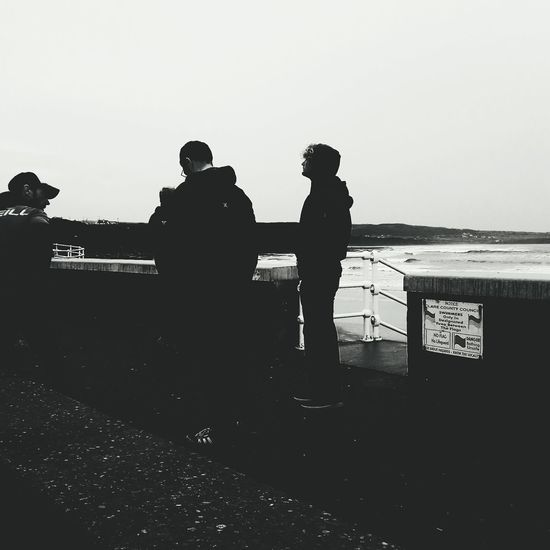 Waiting game... Silhouette Outdoors Water Sea Standing Surf Instructors Beach Lahinch Lahinch Beach Waiting People Togetherness Teamwork Day Young Adult Men Ireland Landscapes