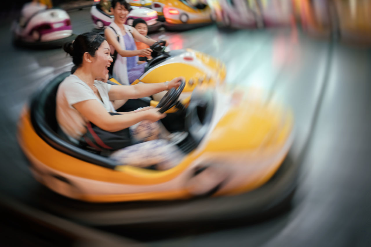 Blurred Blurred Motion Bumper Cars Children China Dalian Dodgems Focus On Foreground Funfair Laughing Leisure Activity Motion Outdoors Young Adult Young Women