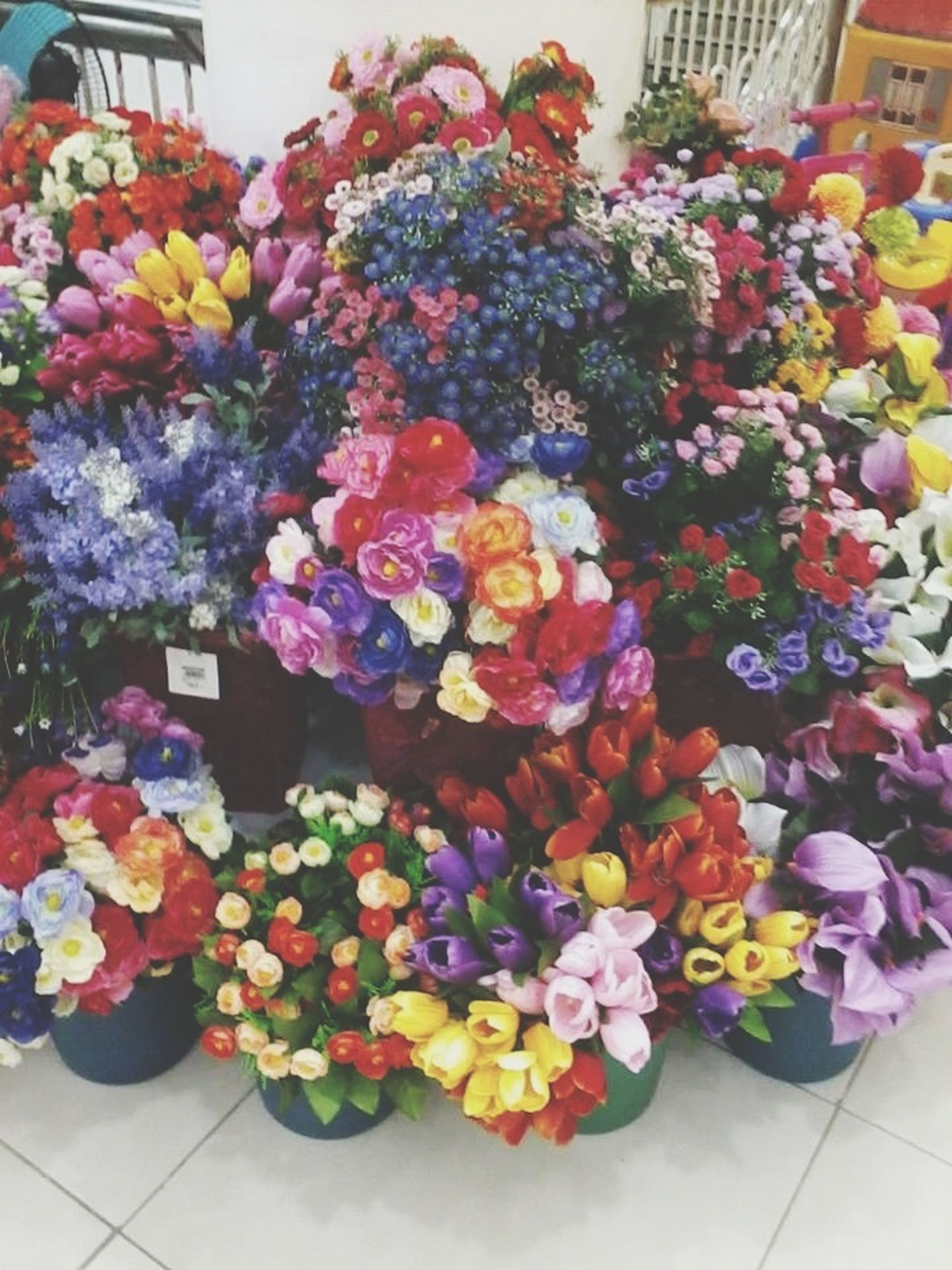 flower, freshness, variation, abundance, multi colored, for sale, choice, retail, large group of objects, arrangement, indoors, bouquet, market, fragility, collection, high angle view, market stall, decoration, various, bunch of flowers