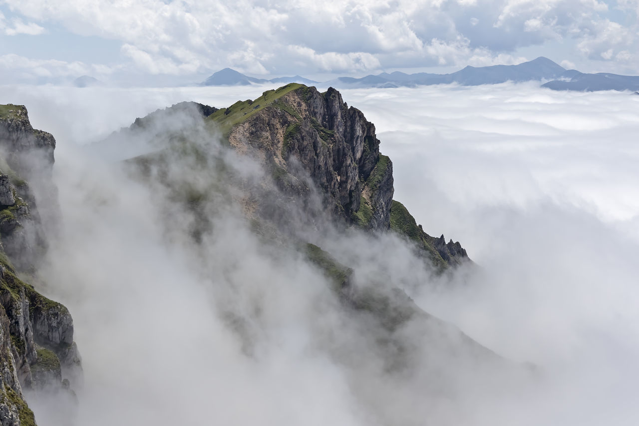 Mountains of the Picos de Europa with fog, in the Community of Cantabria, Spain Beauty In Nature Cloud - Sky Clouds Day Fog Mountain Nature No People Outdoors Physical Geography Rock - Object Scenics Sky