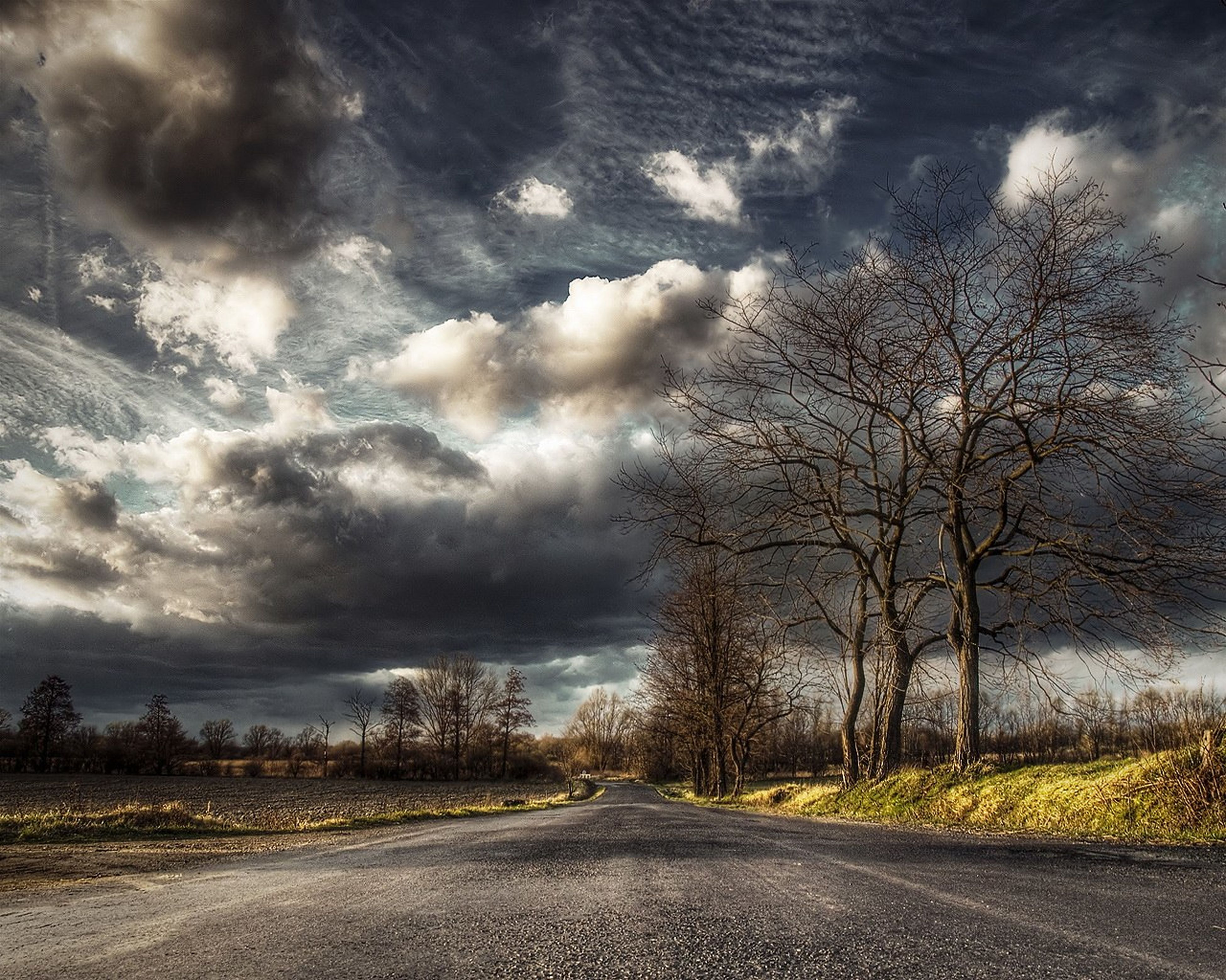 the way forward, sky, road, cloud - sky, transportation, cloudy, diminishing perspective, weather, tree, vanishing point, country road, tranquility, empty road, street, nature, tranquil scene, landscape, cloud, overcast, scenics