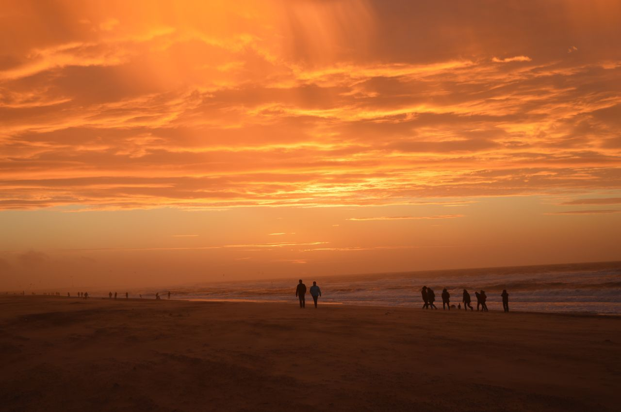 On the beach Hello World Den Haag, Netherlands Orange Sunset Sky And Beach People Walking Afternoon Sun Beach Silhouette 43 Golden Moments
