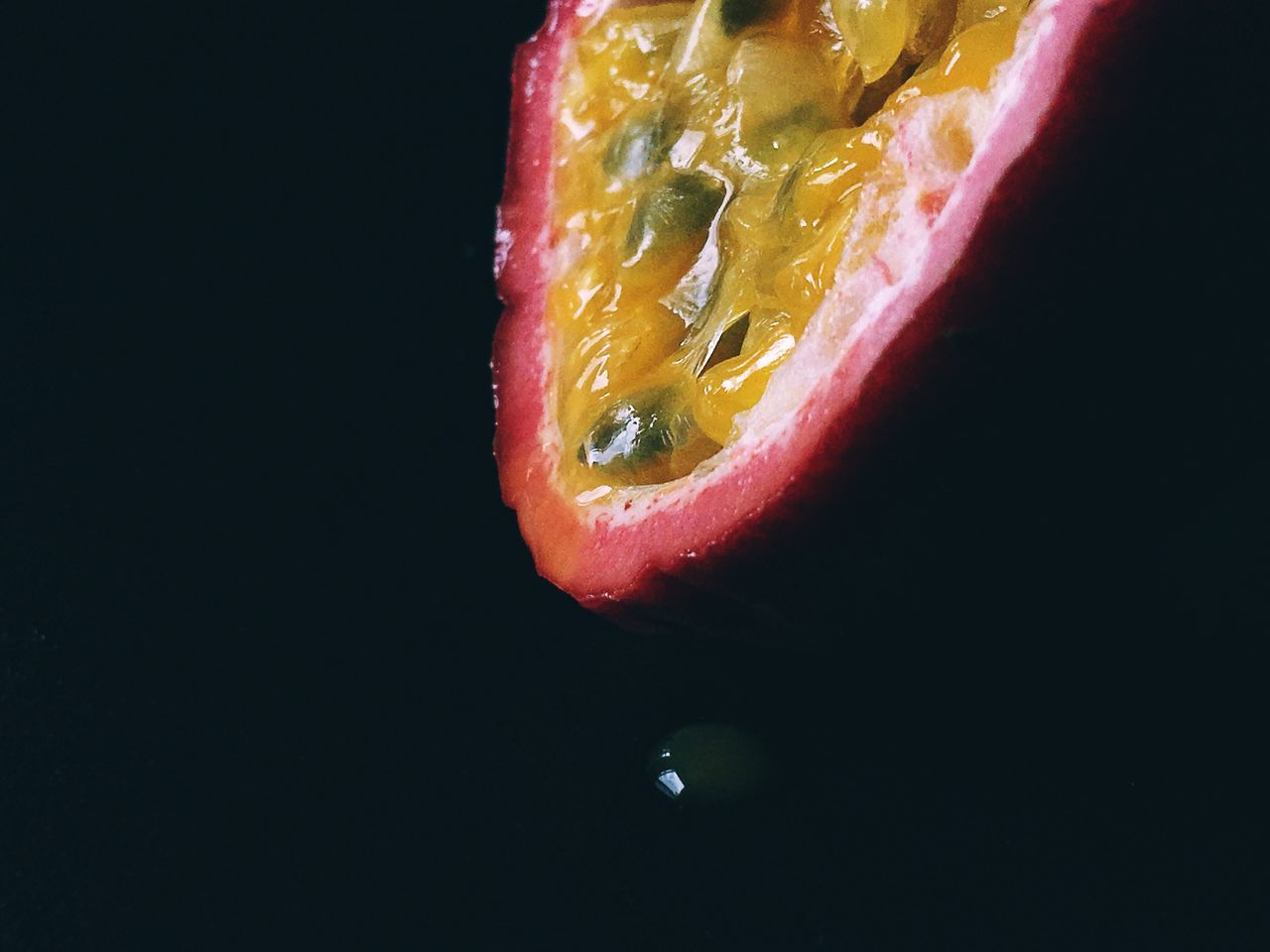 Sliced Passion Fruit On Black Background Fruit Healthy Eating Freshness Food And Drink Black Background Studio Shot No People Tropical Fruit Raw Food SLICE Food Cross Section Close-up Indoors  Passion Fruit Ready-to-eat Halved Sweet Food Still Life Drop Juicy Horizontal Photography Color Image Yellow