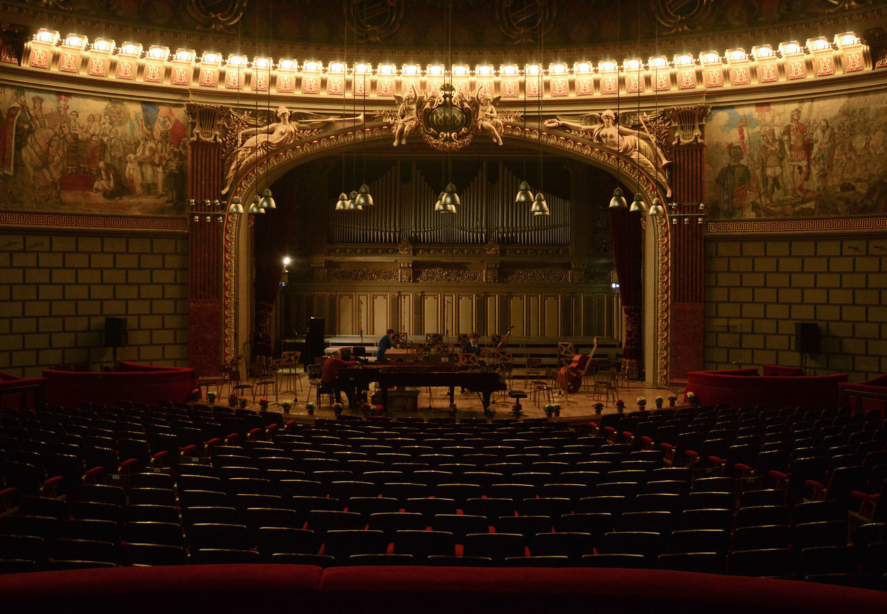 Ateneul Roman, the tuner and the ladies Arts Culture And Entertainment Ateneul Roman Auditorium Baroque Style Concert Hall  Curtain Few People Piano Piano Moments Quiet Moments Repetition Theatre Vintage