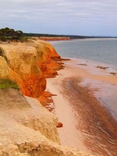 Beauty In Nature Cliff Geology Outdoors Red Cliffs Scenics Sea