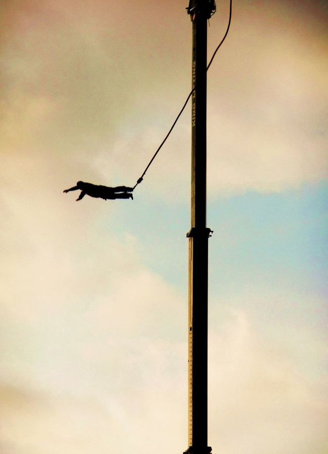 Man hanging in air Transportation Sky Mode Of Transport Flying Low Angle View Cloud Cloud - Sky Journey Day Flight Crane Rope Thrill Seeker Adrenaline Junkie Swinging Up High High Up Cloudscape No People Cloudy Atmospheric Mood Suspended Fun Man Hanging