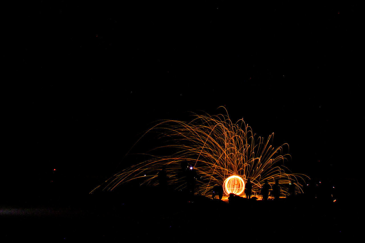 steel wool spinning Exploding Formation Illuminated Long Exposure Motion Night Outdoors Sparks Steel Wool Steelwool Steelwoolphotography Wire Wool