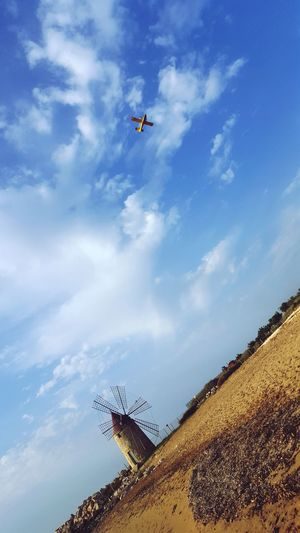 Trapani in the hot day ,The airplane bring water from the sea to stop fire in the moutain. Flying Mid-air Sky Air Vehicle Airshow Low Angle View Airplane Day Outdoors Stunt People Nature