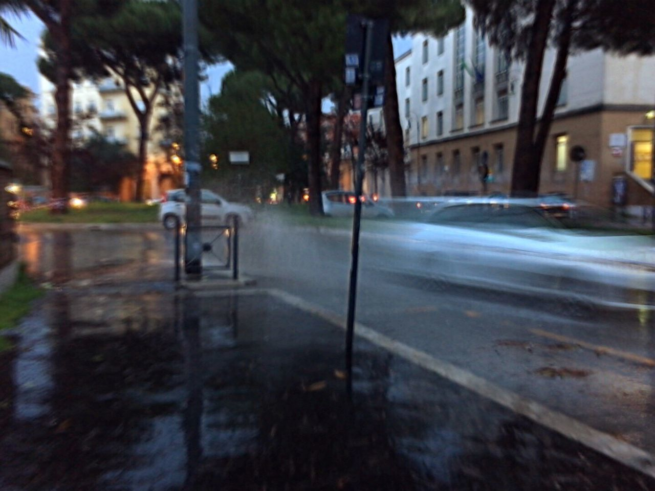 Blurred Motion Of Cars On Wet Road In City