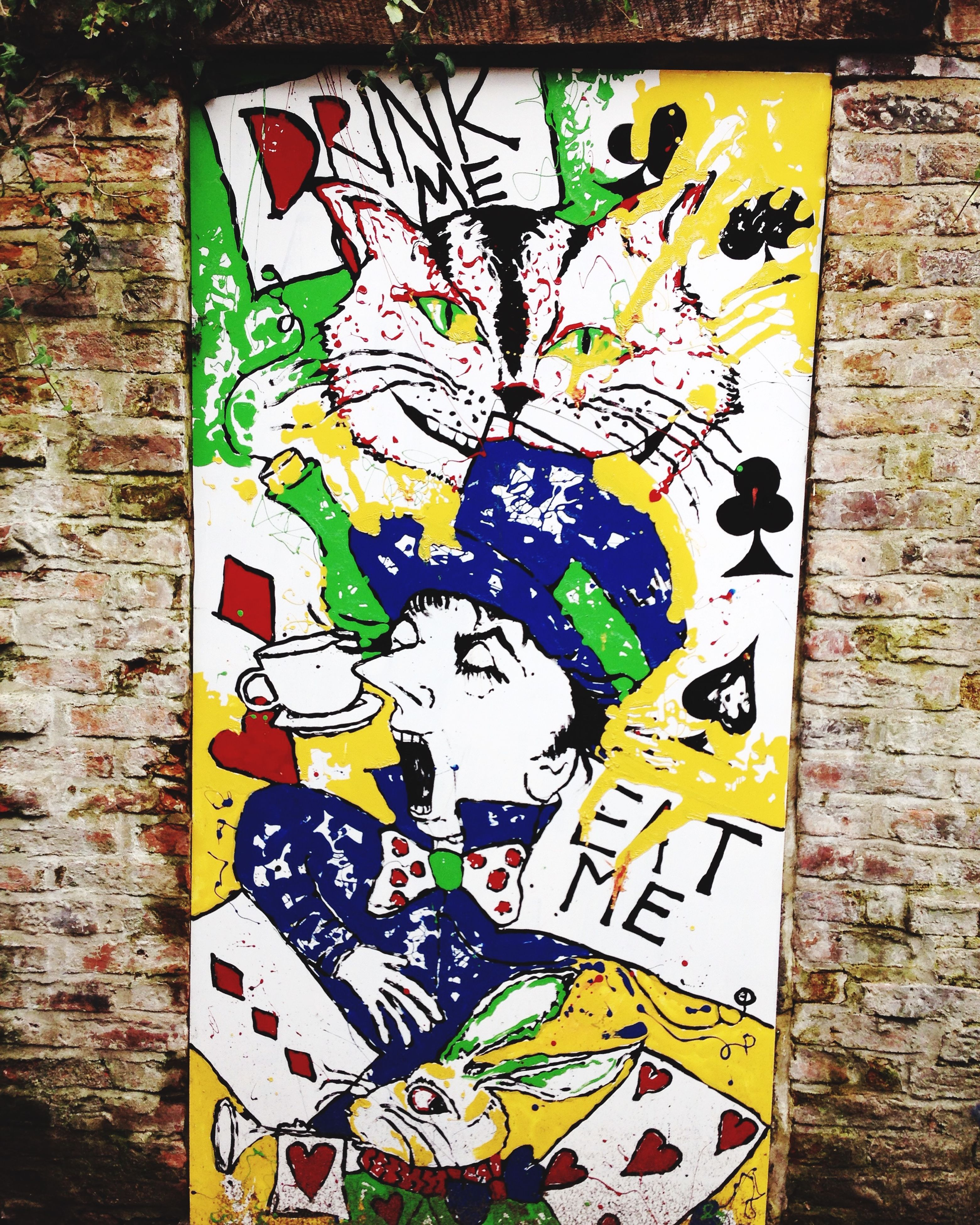 graffiti, art, wall - building feature, art and craft, creativity, multi colored, built structure, architecture, text, wall, street art, brick wall, human representation, communication, building exterior, western script, painting, yellow, mural