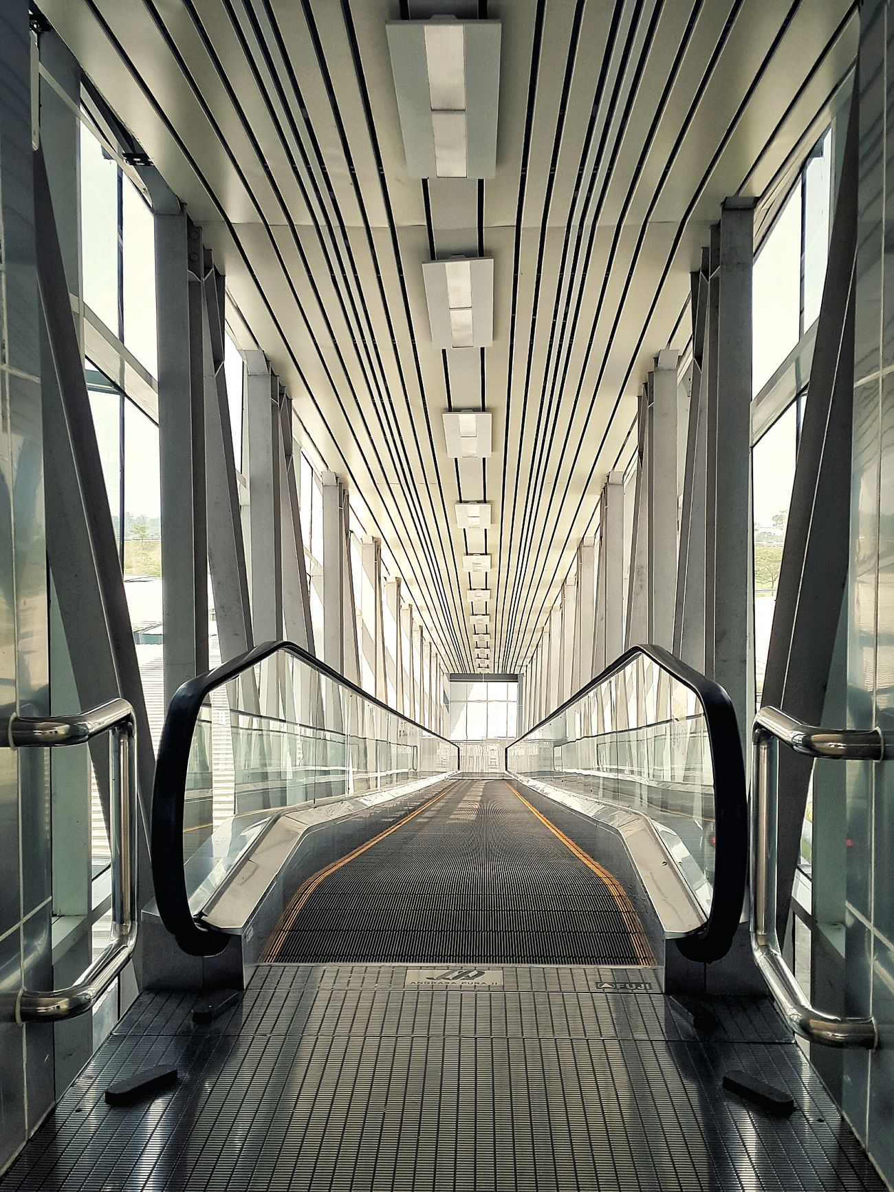 Escalator Vanishing Point Geometric Shapes Stripes Everywhere at Kualanamu airport, Medan INDONESIA