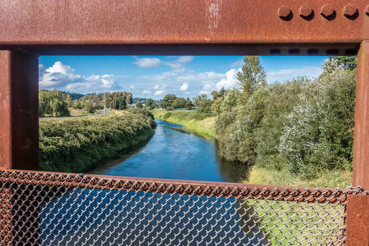 A view of the Green River in Kent, Washington from a rusty bridge. Green River Kent Pacificc Northwe Architecture Beauty In Nature Bridge - Man Made Structure Day Landscape Nature No People Outdoors River Scenics Sky Water
