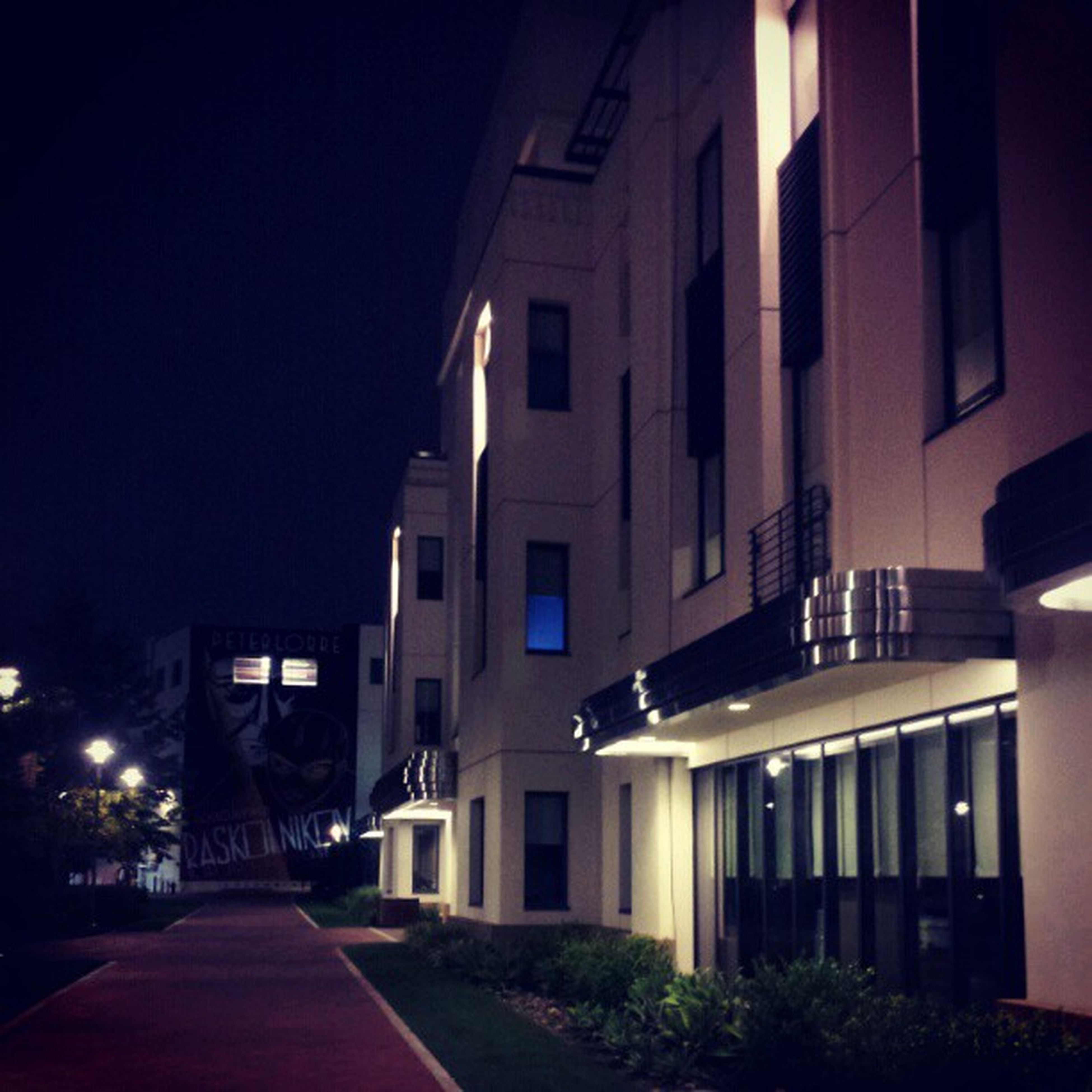 architecture, built structure, building exterior, night, illuminated, the way forward, city, street, building, residential building, residential structure, sky, diminishing perspective, street light, road, outdoors, no people, house, empty, long