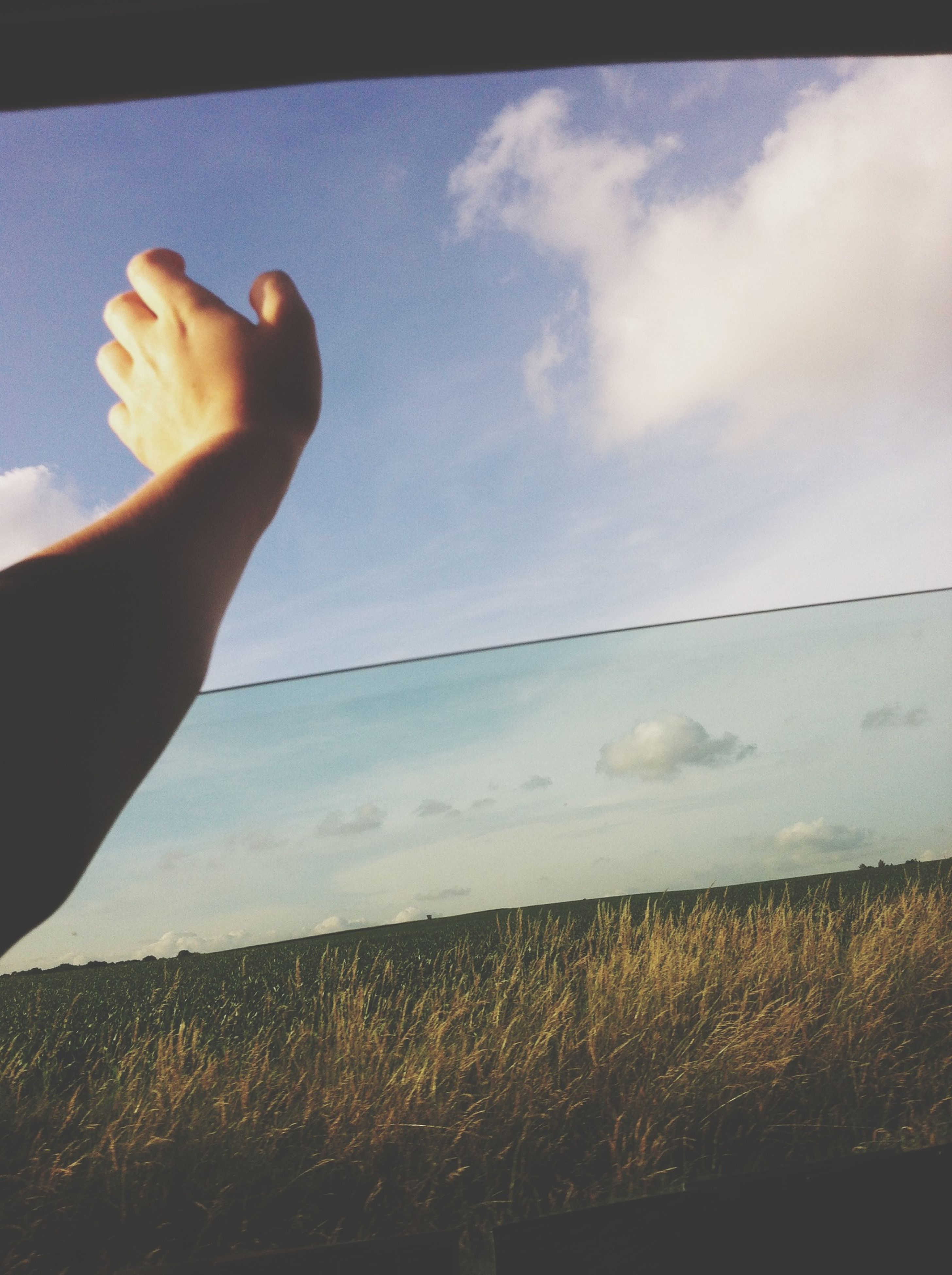 person, part of, sky, holding, cropped, human finger, lifestyles, unrecognizable person, leisure activity, personal perspective, men, cloud - sky, cloud, one man only, day