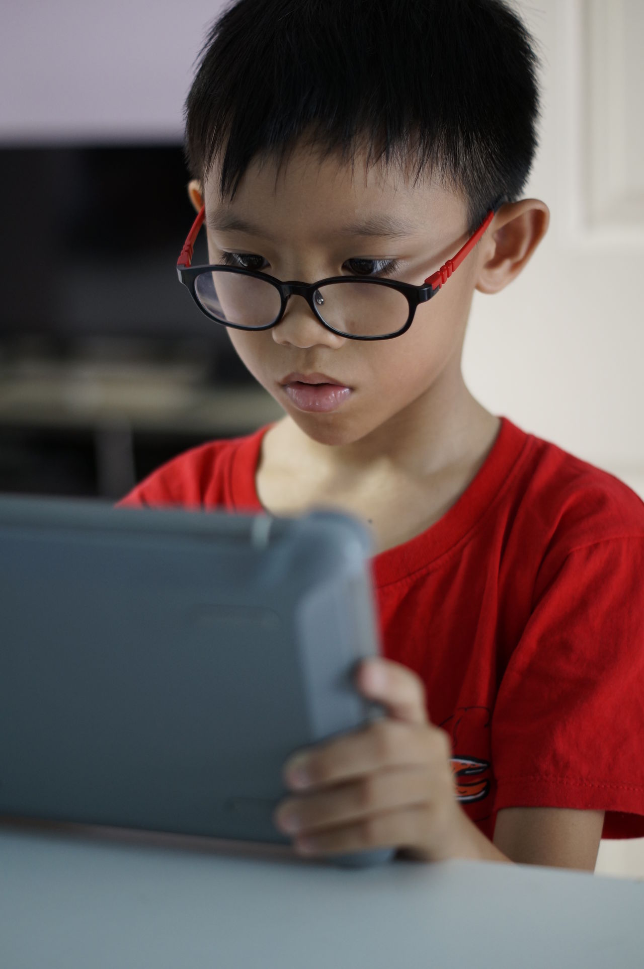 Boy play game online in ipad. Childhood Children With Tablet Children With Toys Close-up Digital Tablet Game Online Headshot Indoors  Ipad Lifestyles One Person Online Game Real People Technology Watching Ipad Watching Laptop