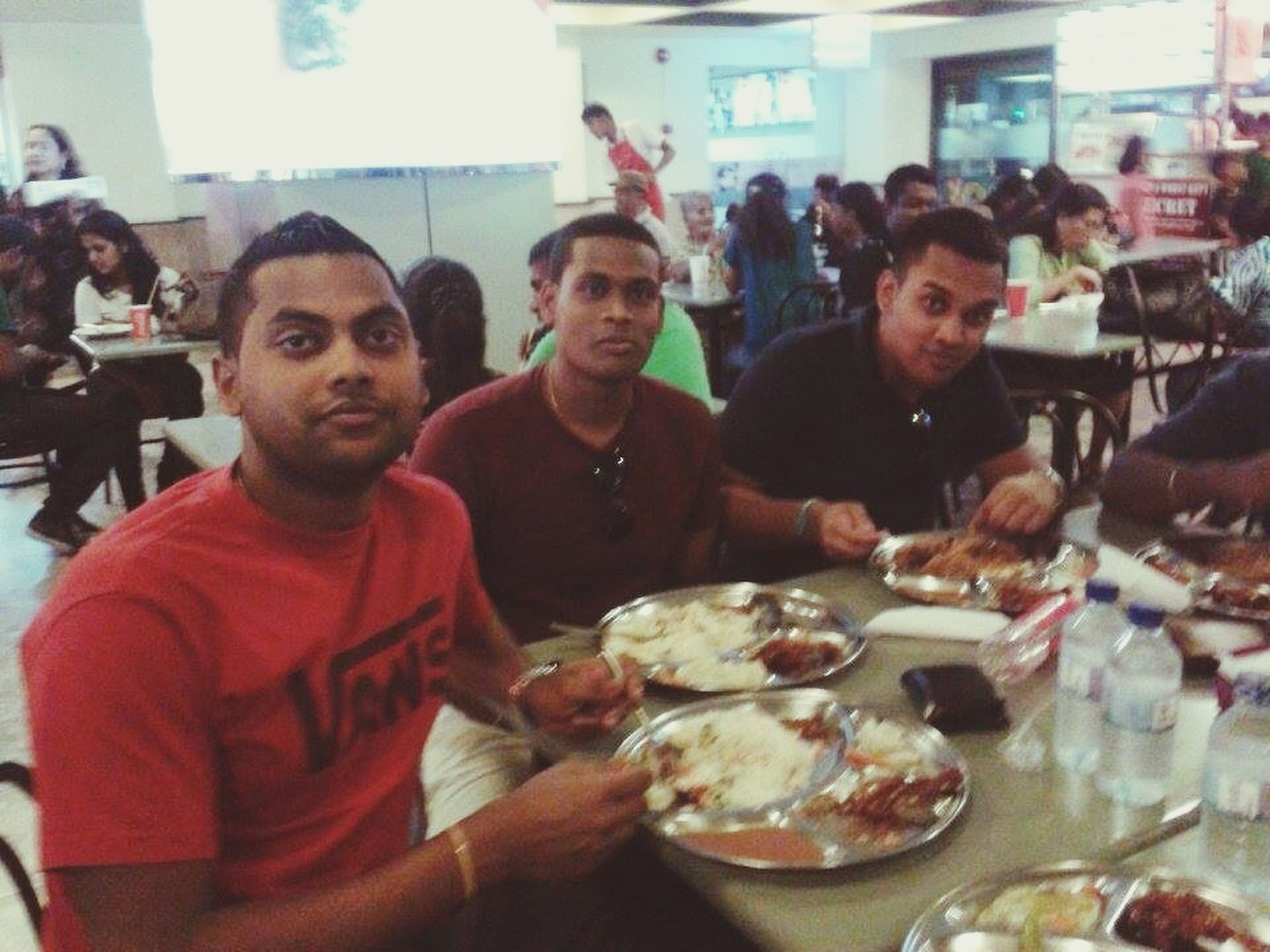 lifestyles, indoors, leisure activity, casual clothing, food and drink, portrait, person, togetherness, looking at camera, young men, sitting, men, bonding, happiness, front view, smiling, restaurant