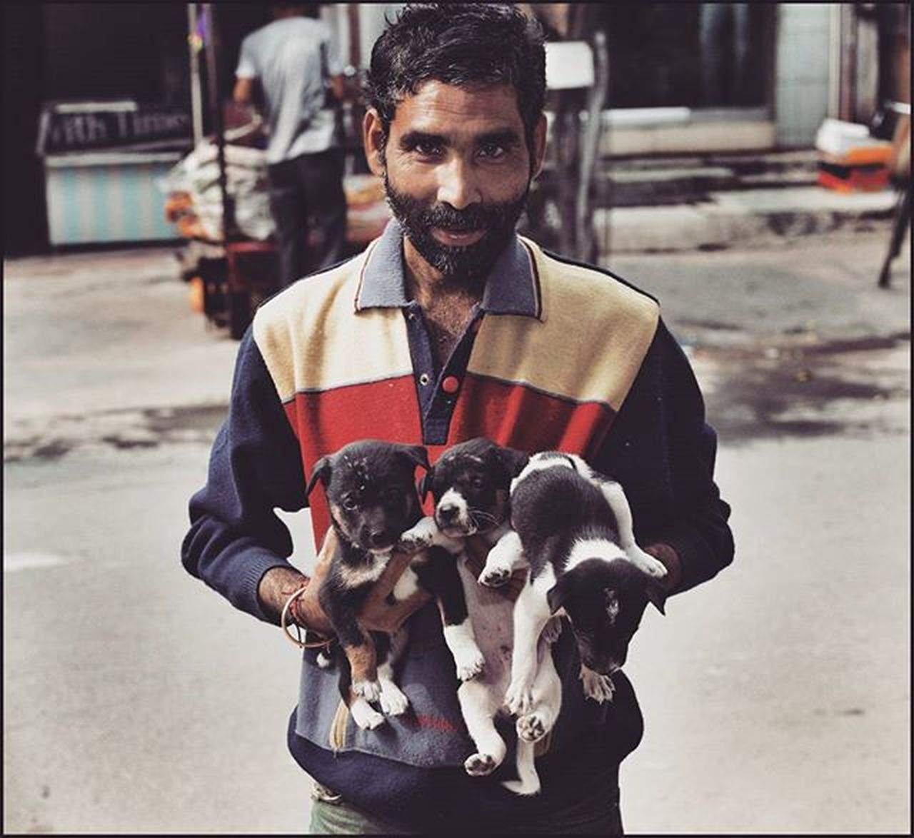 The dog man. Found this guy at the farmers market taking care of 10 puppies. It seems the only thing you need to help others is a big heart, rest will follow. Clicked at Cooch Behar, West Bengal, India. WestBengal Dog Dogs Streetphotography Street Puppies Puppiesofinstagram Punephotographylovers Puneclickarts Puneinstagrammers Betterphotography Lonelyplanetindia Lonelyplanet Generous Begenerous @betterphotography @lonelyplanetindia @puneclickarts @puneinstagrammers Indiapictures Indiaphotosociety Dogman Canonlens Canon 50mm Pictureoftheday Travellerslife Travellers @bharatkatha _soi @streetlife_award