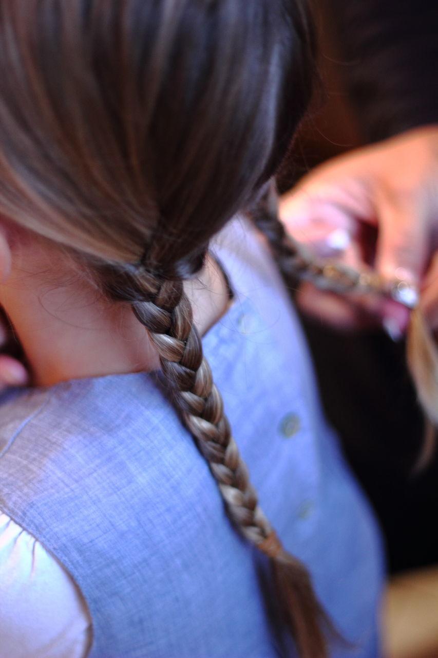 Girl Getting Hair Dressed
