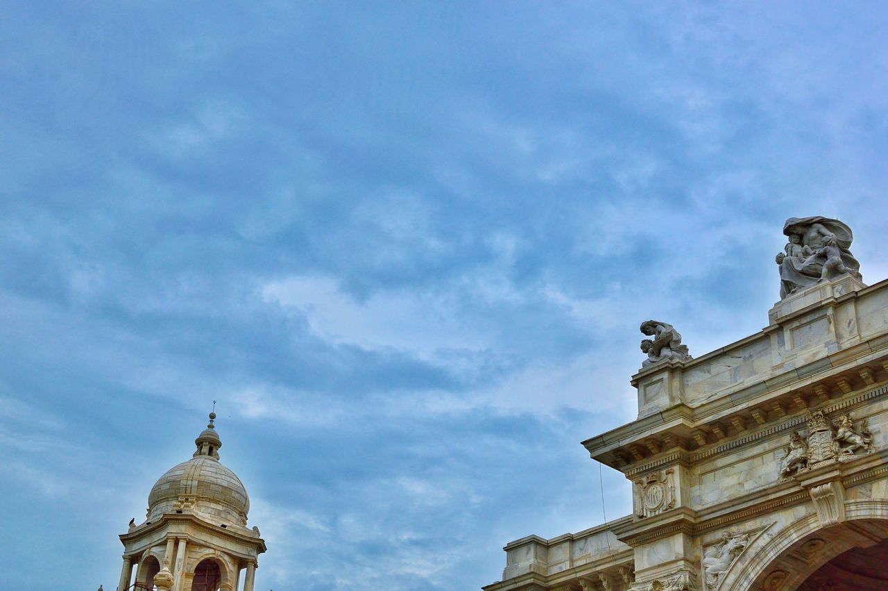 low angle view, cloud - sky, architecture, sky, history, statue, dome, sculpture, day, built structure, outdoors, building exterior, travel destinations, no people, spirituality