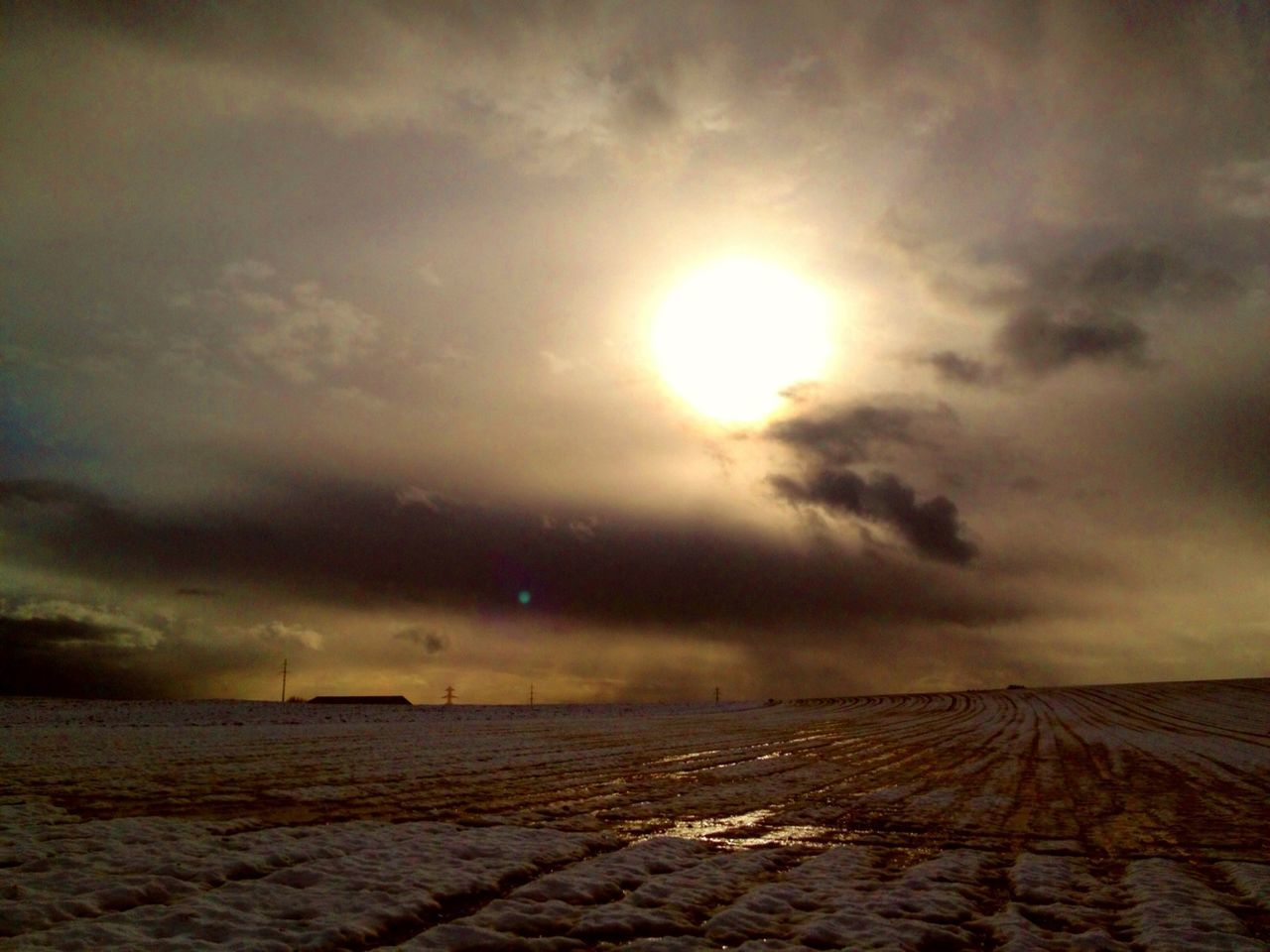 nature, tranquil scene, sky, scenics, sunset, beauty in nature, sun, tranquility, cloud - sky, landscape, weather, outdoors, field, no people, agriculture, rural scene, winter, day
