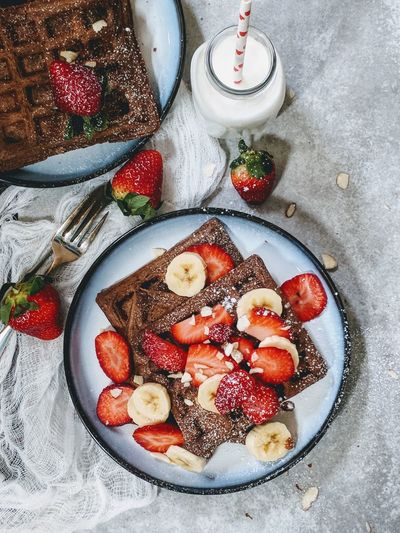 Chocolate Waffles topped with berries Overhead View Top Down Chocolate Waffes Breakfast Strawberries Food And Drink High Angle View Indoors  Plate Food No People Directly Above Fruit Freshness Ready-to-eat Sweet Food Close-up