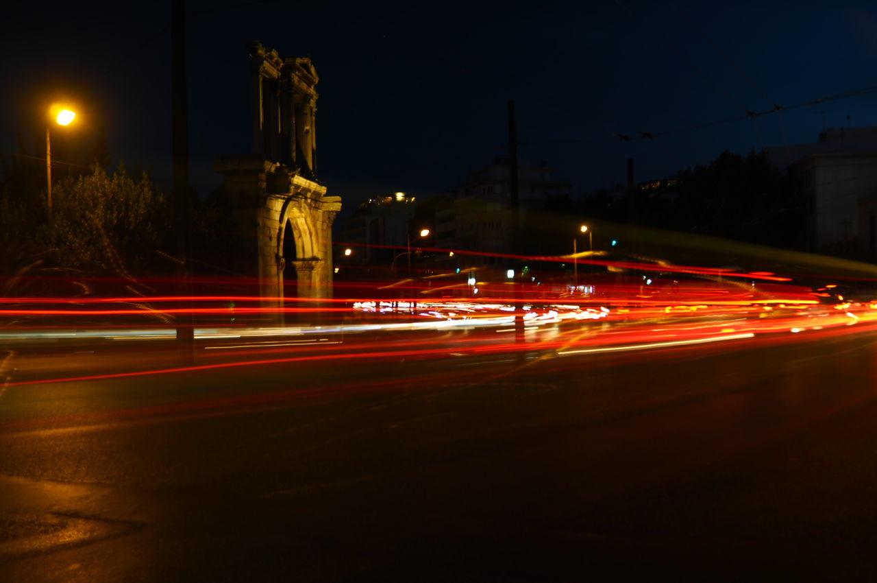 night, long exposure, light trail, speed, illuminated, motion, blurred motion, transportation, high street, street, road, street light, outdoors, no people, urban scene, city, sky