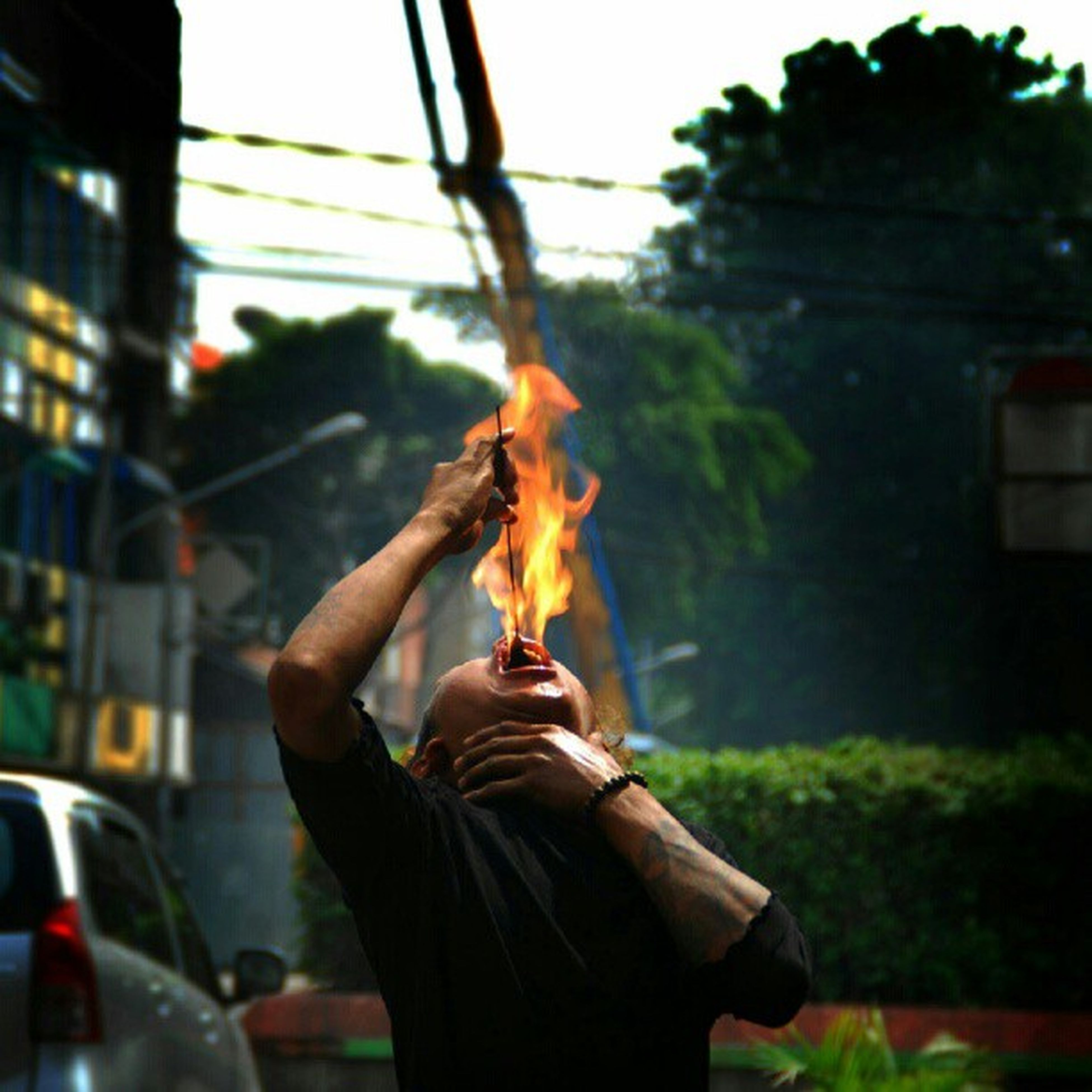 lifestyles, focus on foreground, person, men, holding, leisure activity, flame, burning, selective focus, unrecognizable person, outdoors, close-up, fire - natural phenomenon, part of, standing, cropped